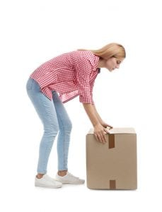 Hire moving company young woman trying to lift heavy box