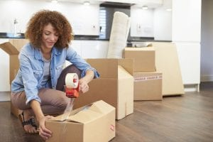 moving supplies woman packing movers ready