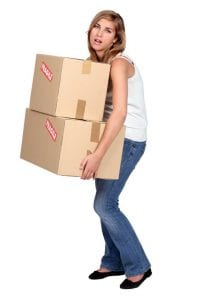 woman carrying heavy boxes moving company can help
