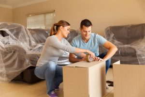 couple getting ready for movers moving supplies